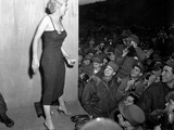Marilyn Monroe, Poses for the Army Shutterbugs after a Performance at the 3rd US Infantry Division Posters