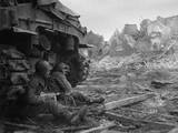 U.S. Infantrymen Sheltering Behind a M-4 Sherman Tank During Heavy German Shelling Photo