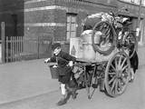 A Boy Pulls, as His Mother Pushes, a Cart Loaded with their Possessions in Uerdingen, Germany Prints