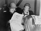 After Working All Night, Two Helmeted Women Shipyard Workers Read the Newspaper on the Bus Home Prints