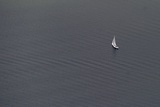 Aerial View of Sailboat in the Water Photo