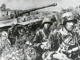 German Infantry in Camouflaged Clothing Retreating with a Tank on the Kuban Front Photo