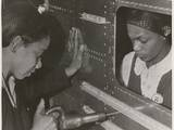 African American Women Riveters Work on the Center Section of a Bomber During World War 2 Photo