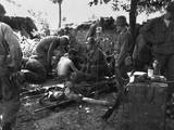 U.S. Soldiers Receive Medical Treatment at a First Aid Station Near South Korean Battle Front Print