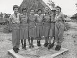GI 'Little Abners' Shoes are Modeled by Nurses of a Medical Regiment in New Guinea, Port Moresby Photo
