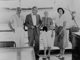 Henry Luce, Allen Dulles, Clare Boothe Luce, and Billie Cassady, (L-R) Aboard the Yacht 'Niki' Posters