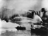 London Firemen Direct Water from their Fireboats onto Blazing Warehouse Photo