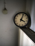 An Old Clock Perched on a Radiator in the Train Station in Dresden, September 2010 Photo