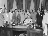 President Harry Truman Signing H.R. 5632, the National Security Act Amendments of 1949 Photo