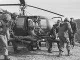 A Seriously Wounded U.S. Marine Is Rushed to Helicopter by the Corpsmen Posters