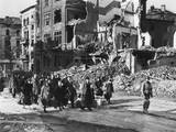 German Civilians Carry Belongings as They Follow an American Soldier Out of Aachen, Germany Prints