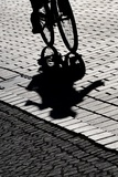 A Cyclist's Long Shadow Is Thrown onto the Street in Kempten, Germany Photo by Karl Josef Hildenbrand