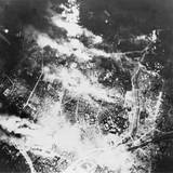 Aerial View of Tokyo Burning Following Incendiary Bombing by B-29S, on the Night of May 26, 1945 Posters
