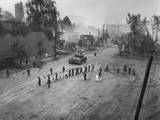 U.S. Marine Tank Follows a Line of Prisoners of War Down a Street, Sept. 26, 1950 Photo