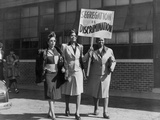 Three African American Women with Sign Reading, 'Segregation Is Discrimination' Photo
