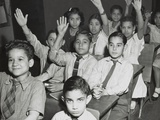 Puerto Rican Children in a Classroom, Some with Hands Raised. New York City, April 25, 1947 Posters