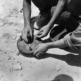 Two Italian Soldiers Disarming a Land Mine in the Axis Occupied Zone of Egypt, 1942 Photo