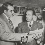 Gangster Johnny Rosselli (Right) Checks a Writ of Habeas Corpus with His Lawyer, Frank Desimone Fotografía