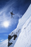 Skier Jumping from Mountain Ledge Photographie