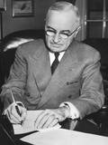 President Harry Truman at His Signing a Proclamation Declaring a National Emergency Photo