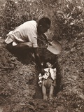 Man Burying a Child in a Shallow Grave in a Rural Hengyang or Yunnan Province, China Photo by Arthur Rothstein