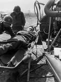 Wounded U.S. Soldier Lifted onto a Helicopter for Evacuation to a Base Hospital Photo