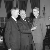 President Harry Truman Presenting Chemist Dr. James Conant with the Medal of Merit Posters