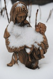 A Sculpture of a Saint with Snow on It, Taken in a Cemetery in Osterode Am Harz Posters