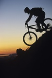 Mountain Biker Riding Down Slope Photo