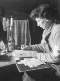 U.S. Army Nurse Writes a Letter Home after 12 Hours of Work Photo