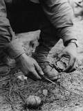 U.S. Soldier Dismantles a German Booby Trap Planted on the Road to St. Gilles Photo