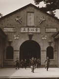 Children Running Out the Entrance of a School Building in China Photo by Arthur Rothstein