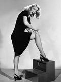 Marie Wilson, Showing How to Forgo Garters by Rollings Your Stockings, Ca. 1940s Photo