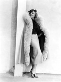 Marlene Dietrich, in a Brown and Beige Suit and Lynx-Trimmed Beige Wool Cape by Travis Banton, 1935 Print