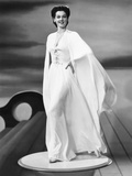 Rosalind Russell in an Evening Dress and Cape Designed by Valentina, 1941 Print