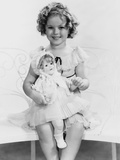 Shirley Temple, with a Shirley Temple Doll, Ca. 1935 Posters