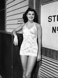 Esther Williams, Who's Had Her Fellow Players Autograph Her Swimsuit, 1942 Photo