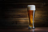 Beer Glass on a Wooden Background Photographic Print by Alexandr Vlassyuk