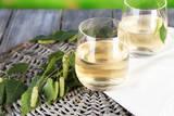 Glass of Fresh Birch Sap Photographic Print by Africa Studio
