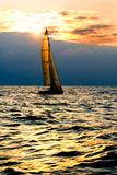 Sports Yacht in the Sea at Sunset. Photographic Print by  Knevich