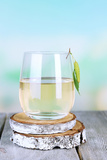 Glass of Fresh Birch Sap on a Wooden Table on Nature Background Photographic Print by Africa Studio