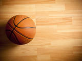 An Official Orange Ball on a Hardwood Basketball Court Photographic Print by Wouter Tolenaars
