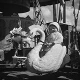 L'enfant sage, manège aux animaux Photographic Print by  Feher