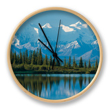 The Rugged Snow-Covered Peaks of the Alaska Range and Shore of Wonder Lake Clock by Howard Newcomb