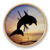 Bottlenose Dolphins Leaping Out of the Water at Twilight (Tursiops Truncatus) Clock by Marty Snyderman