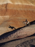 Rider with Shadow Coming down Hill in Painted Desert Photographic Print by Terry Eggers
