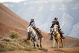 Cowgirl & Cowboy at Full Gallop Photographic Print by Terry Eggers