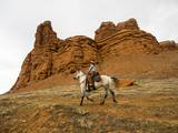 Cowgirl at Full Gallop with Red Rock Hills Photographic Print by Terry Eggers