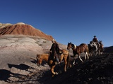 Riders and Horses with Shadows Coming down Hill in Painted Desert Photographic Print by Terry Eggers