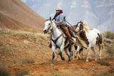 Cowgirl at Full Gallop with Horses in Tow Photographic Print by Terry Eggers